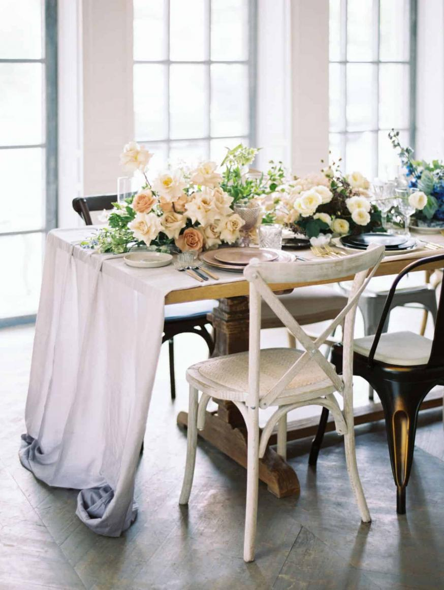 A beautifully laid table with florals and delicate place settings