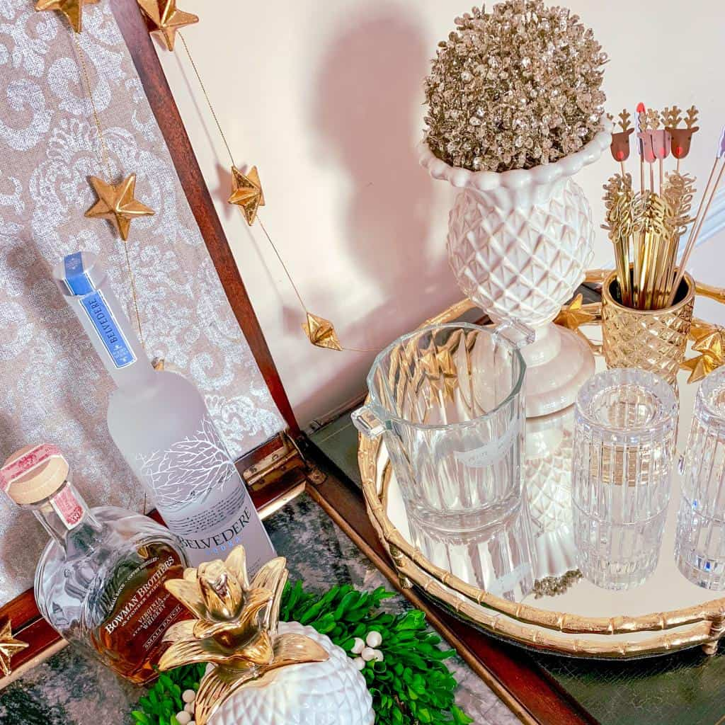 Photo of a styled bar for New Year's Eve with Baccarat double old fashioned crystal glasses and holiday decor.