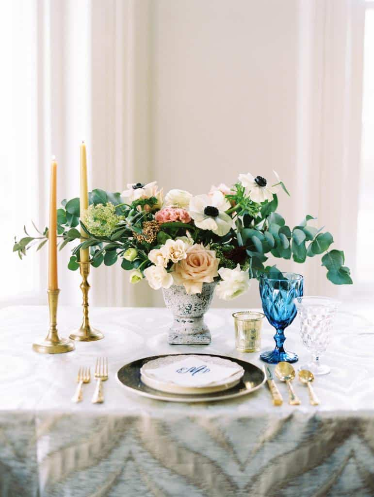 Pretty tablescape featuring gold, blue and cream accents