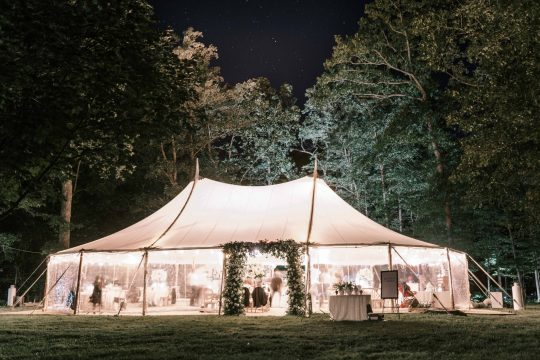 Goodstone Inn wedding design - nighttime photo of lit sailcloth tent and stars